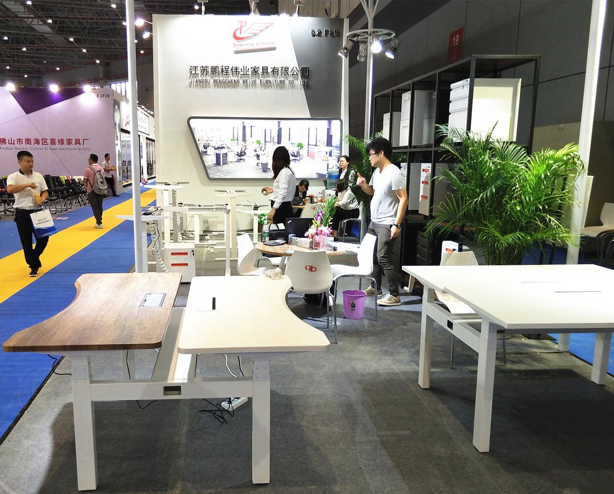 Pengcheng electric height adjustable desk on CIFF Shanghai